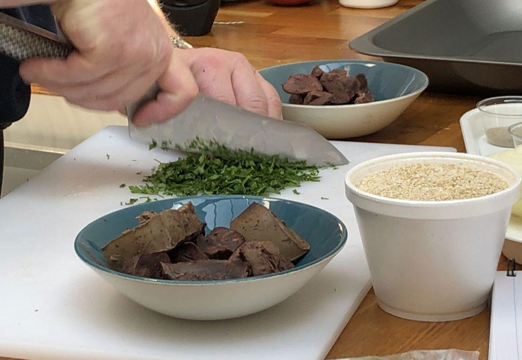 Slicing herbs to make haggis